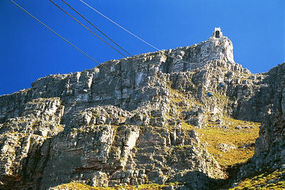 Cable cars to the top of table mountain. Look closely, they are there.